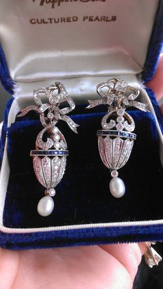 Victorian 14k Gold, Diamond and sapphire bow-topped earrings with Pearl drop terminal.