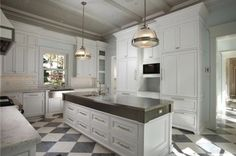 Awesome, brand-spanking-new, grey and white kitchen. Love the grey and white floor and the grey beadboard ceiling.