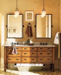 one cabinet, two sinks and two mirrors