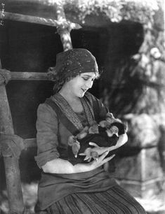 "Mary Pickford cradles ducklings in ""The Love Light"" (1921)."