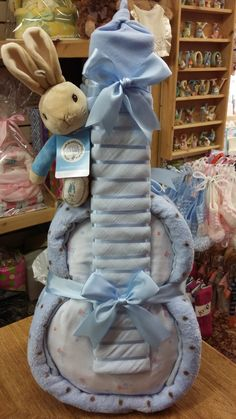 Blue Nappy Guitar made from: Pram Blanket, 2 x Muslin Cloths, Cotton Hat, Gro Swaddle, Peter Rabbit soft toy & 25 size 3 disposable nappies.