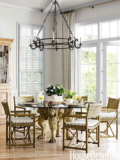 This sunlit breakfast room has a friendly round table whose beech-wood base is carved with lions' heads and paws.