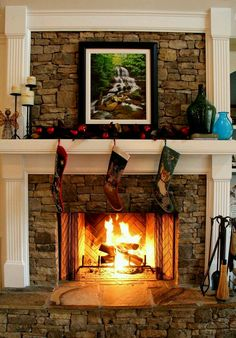 the wood mixed with the fireplace adn the slate hearth. Whats with the picture? don't like that on this fireplace, especially at Christmas. Stone Veneer Fireplace, Stacked Stone Fireplaces, Fireplace Redo, Rock Fireplaces, Fireplace Hearth, Fireplace Remodel, Fireplace Surrounds, Fireplace Design, Fireplace Ideas