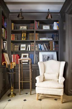cozy nook with shelves and cream wing chair!