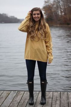 Perfect fall outfit including a Barbour coat, United tee fall t-shirt, and black hunter boots. If you want to know how to style hunter boots this is it! Check it out on my fashion blog daily dose of charm by Lauren Lindmark dailydoseofcharm.com