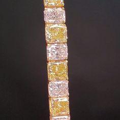 this Stunning Natural Fancy color diamond bracelet crafted in solid platinum and 18K yellow gold. It is beautifully adorned by 32 Radiant-Cut Natural Fancy Vivid to Natural Fancy Intense and colorless diamonds. Yellow Diamond Engagement Ring, Antique Engagement Rings, Bracelet Crafts, Bracelets, Radiant Cut, Colored Diamonds, Fancy, Natural, Gold