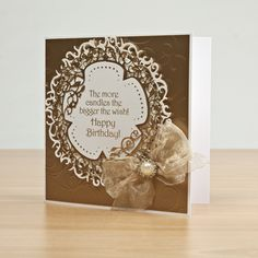 Gold and white embellished card using Tonic Studios. All products available at Create and Craft! - http://www.createandcraft.tv/papercraft/brand--tonic+studios.aspx?icn=Tonic&ici=Tonic_Papercraft_Brands