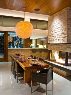 Gorgeous center fire place with bar and dining.