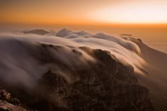 Table Mountain's Cloudy Tablecloth: This gorgeous phenomena of clouds pouring over the top of Table Mountain in Cape Town, South Africa, is what gave the mountain it's name. (Photo by Laura Grier/National Geographic Traveler) National Geographic Traveler Magazine, Beautiful World, Beautiful Places, Amazing Places, Table Mountain Cape Town, Cape Town South Africa, Travel Magazines, Photo Contest, Beautiful Landscapes