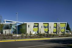 Built by TCF Architecture in , United States with date 2011. Images by Pete Eckert. McMicken elementary school seeks to convert the client's practical requirements of sloping roofs and durable material...