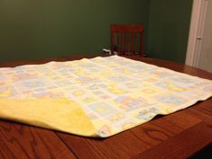 """PRICE: $25.00. Flannel Noah's Ark blanket with yellow backing (""""41 X 34"""") MADE BY KRIS"""