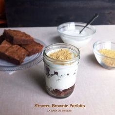S'mores Brownie Parfaits - Layers of brownies, toasted marshmallow sauce and crushed graham crackers. All the flavors of s'mores in every bite. Plus, you can make the parfaits in jars to share at a fall picnic, or whenever you're in the mood to dig into some s'mores.