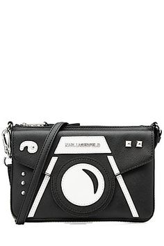 Tap into the playful and kooky appeal of Karl Lagerfeld's accessory line, starting with this black and white printed shoulder bag. The camera design adds a cool edge with glossy studs for added texture #Stylebop