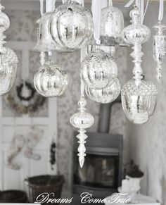 Dreams Come True… like this gorgeous display of silver ornaments hanging from a chandelier! Fabulous!