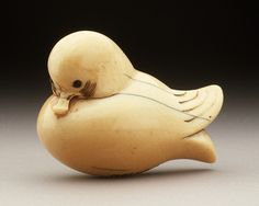 Japan  Simplified Mandarin Duck, 19th century  Netsuke, Ivory with staining, sumi, inlays, red pigment. LACMA