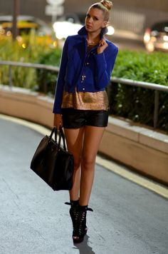 Black leather shorts, bronze jumper and blue jacket, black tote and booties. 20 Urban Street Style Combinations by Famous Fashion Bloggers