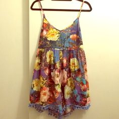 LF Stores Mika & Gala Floral Pom Pom Hem Romper Awesome easy oversized romper. Pretty short and style doesn't work great if you are big chested. The hem is lined with Pom poms and floral print is so pretty. Perfect for traveling and HOT days✌️ lightly worn. Size 8 really fits like a 4. LF Other