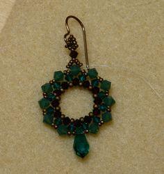 Sidonia's handmade jewelry - 4mm Swarovski Green Opal bi; 3mm Swarovski Emerald bi; 3mm Swarovski Garnet bi; Miyuki 15/0s & 11/0s - Matte Dk Bronze - code 2006
