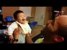WATCH: Dad's Reaction is Almost Better Than Baby's First Laugh