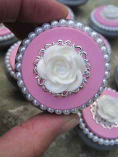 """Shabby Chic dresser drawer knob in Grey and Pink with White Pearls and flower    Great knobs to spruce up that old cabinet!    - 2"""" round wooden knobs (bigger than the standard 1.5"""")  - painted with high quality acrylic paint  - 3 layers of varnish to prot"""