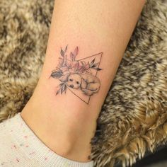 Dog + Flowers in Triangle by @Tattoo_Grain