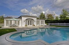 Swimming pool with pool house at luxury home in Briarcliff Manor, New York