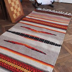Handwoven wool rug with ornaments stylish home decor by RugsNBags