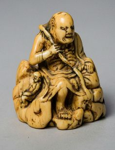 An immortal seated on a rock. Netsuke, Ivory. Japan, 18th century. HEIGHT 4,7 CM  An early rare and expressively modeled ivory Netsuke of an ascetic Immortal (Rakkan) with a characterful head and a stick in one hand. He is sitting on a massive rock with one leg bent and flanked by a naked and tiny man. Himotoshi to rock, good patina. From the collection of Marcel Lorber