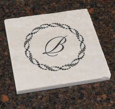 The Rustic Stone Trivet will make a wonderful keepsake gift for the newly married couple or as a housewarming gift for the family who recently moved into their new home.  This tumbled stone trivet has a wreath design and may be personalized with a single initial in font shown.  Will be used for years to come! Rustic Stone, Newlywed Gifts, Tumbled Stones, Newlyweds, Cool Gifts, House Warming, Initials, Newly Married, Favors