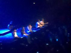 THEYRE SITTING ON THE EDGE OF THE STAGE SINGING LITTLE THINGS TO THE PEOPLE IN THE FRONT ROW IM SCREAIMING