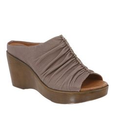 Take a look at this Taupe Eva Peep-Toe Slide by Kravings by Klogs on #zulily today! $54.99, regular 125.00.  PRODUCT DESCRIPTION: Tantalize toes with these comfortable treats boasting Klog's signature Komfort technology. Supple on the outside and contoured within to provide excellent arch support, this pair of slip-resistant slides features an antimicrobial footbed that keeps feet feeling sweet.   3.5'' heel Leather upper Leather lining Man-made sole