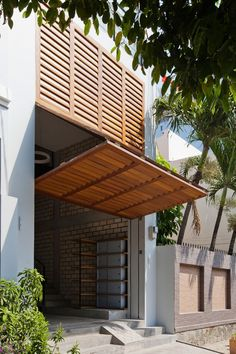 Townhouse with a Folding-Up Shutter by MM architects (3)