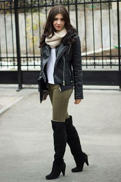 Simple and basic winter look made fashionable with biker leather jacket, high boots  and a sweater scarf.