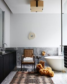 Xoco Penthouse New York, NY. Tapped by DDG Partners to stage the penthouse in their new building Xoco, Neal Beckstedt Studio transformed the expansive four-bedroom home into an elegant retreat infused with modern sophistication and ease. Chic Bathrooms, Dream Bathrooms, Modern Bathroom, Bathroom Layout, Bathroom Colors, Bathroom Island, Bathroom Ideas, Bathroom Showers, Bathroom Inspo