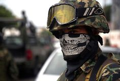 """Mexicos Drug War: 50,000 Dead in 6 Years.  A masked Mexican soldier patrols the streets of Veracruz, on October 10, 2011. Soldiers of the Army, Navy and members of Federal Police patrol the streets of the city as part of """"Veracruz Safe Operation"""" after a rising tide of violence plaguing this tourist city. (Yuri Cortez/AFP/Getty Images)"""