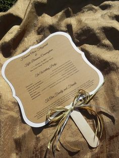 Ornate Square Rustic Chic Wedding Program- Fan Style with Gold and Silver Raffia. $2.00, via Etsy. @Breann Barrick I love this one too haha