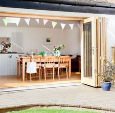 Wood bi-fold doors on to garden (image from House to Home)