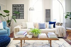 Alison's Collected and Curated Apartment | Airy and inviting. Love the off-white carpet with washed-off blue patterns; matches well with the hints of blue in pillows and books.