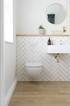 white bathroom This customer decided to opt for a more contemporary style in their bathroom with our Aged Oak Porcelain on the floor and these very on-trend white metro tiles on the wall Downstairs Bathroom, Bathroom Layout, Bathroom Interior Design, Master Bathrooms, Bathroom Mirrors, Modern Bathrooms, Bathroom Cabinets, White Bathroom Wall Tiles, Bathroom Ideas White