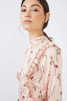The perfect piece for the 'pretty girl', this feminine spot floral jacquard dress comes in a sweet pale pink, adorned with ruffle detail to the front and back. Featuring a high neck and long sleeves, it comes in a mini fit. Wear with studded ballerina pumps for an added edge. #Topshop