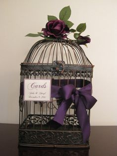 have cage need purple ribbon and sign please.  Birdcage Wedding Card Box / Eggplant / Bird Cage Card Holder via Etsy