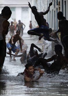 Rain in Havanna, Cuba We Are The World, People Of The World, Life Magazine Archives, Trinidad, Singing In The Rain, Havana Cuba, Portraits, Thunderstorms, Happy People