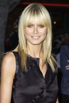 """This Is The Evolution Of The """"It"""" Hairstyle Over The Years #refinery29  http://www.refinery29.com/2016/12/131539/popular-haircuts-celebrity-inspired#slide-8  The Year: 2003The Cut: Layered bob and fringeThe Woman: Heidi KlumBoth Reyman and Sherman recall the ripple effect that Heidi Klum's fringed cut made on the masses when it debuted on the cover of Elle in 2003. """"Michel Aleman cut this Heidi Klum look in Elle, and needless to say, it was a very big deal,"""" recalls Sh..."""