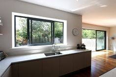 Hedgehog Aluminium Systems designed and installed aluminium sliding doors and aluminium casement windows that have been used as part of the renovation for this home in London. Masonite Interior Doors, Interior Barn Doors, Exterior Doors, Aluminium Windows And Doors, Casement Windows, Sliding Window Design, Sliding Windows, Modern Windows, Kitchen Room Design