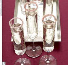 Pink sugar-rimmed champagne glasses