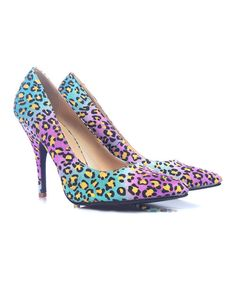 Sneak feisty glamour into any ensemble with the addition of these bright pumps. With a classic shape and energetic leopard print, this pair will become a trusty go-to for an extra touch of footwear flair.4'' heelMan-madeImported
