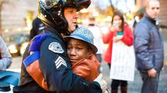 Ferguson riots nation wide, I wish people could see this all over our nation. A white police officer comforting and hugging a black child during a riot over the verdict. Free hugs said the child and the officer needed a hug. And in turn both were comforted in this crazy time for our nation. God bless both of them, they are not ones to look at color.