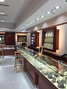 Artco Group Inc. Store Planners, Designers, and Manufacturers of Custom Millwork & Store Fixtures. Specializing in Jewelry Store Design & Fixtures Jewellery Shop Design, Jewellery Showroom, Jewelry Shop, Jewelry Stores, Jewelry Ads, Jewelry Hanger, Jewelry Displays, India Jewelry, Bridal Jewelry
