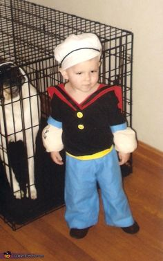 Erin: Eli, 2, as Popeye. I made this costume using a black t shirt which I sewed blue cuffs and muscle arms to the sleeves. Yellow buttons are sewen on the...
