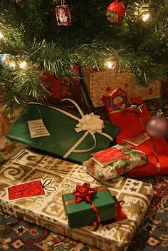 Christmas presents under the tree by Alan Cleaver, via Flickr